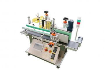 Desktop adhesive labeling machine