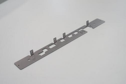 Sheet metal stamping guard plate