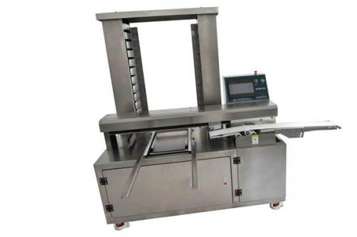 Automatic tray arranging machine